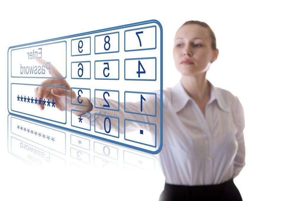 Woman touching a virtual enter icon on a virtual panel